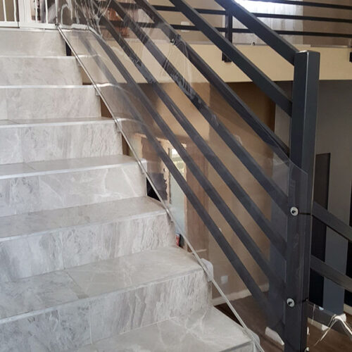 clear-sheeting-protective-guard-for-stairways